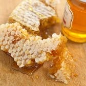 Honey in a jar and a Honeycomb